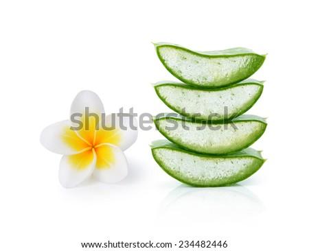 Aloe vera and frangipani flower on a white background. - stock photo