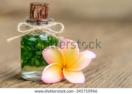 Aloe vera and frangipani flower on wooden - stock photo
