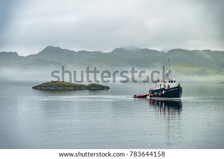 stock-photo-alone-boat-driving-through-i