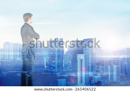 Alone. Double exposure of a city and a businessman - stock photo