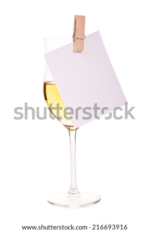 Alone glasses of champagne with blank card - stock photo