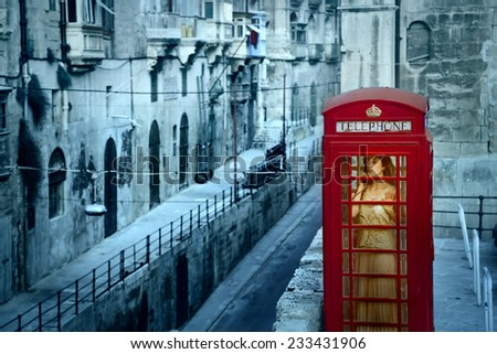 Alone in the phone box  - stock photo