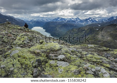 Alone man in silence mountain panorama - stock photo