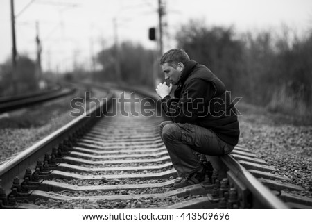 alone man on railway - stock photo