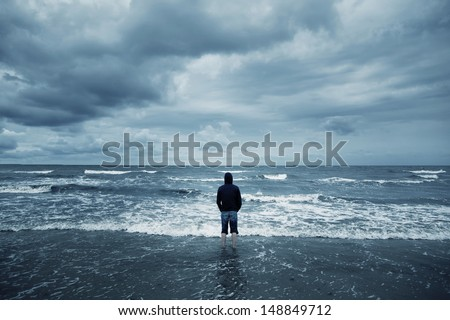alone man on the beach - stock photo