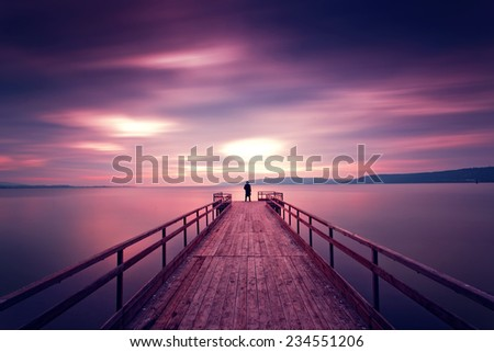 alone man standing at dock and thinking/time to go work - stock photo