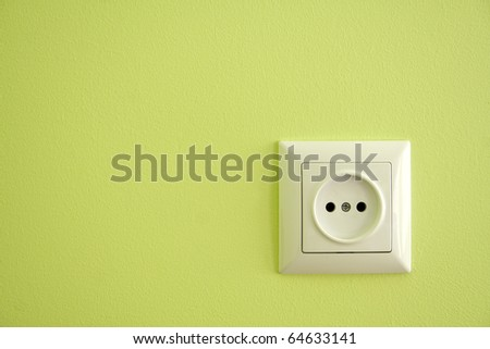 Alone outlet on green baskgrounds - stock photo