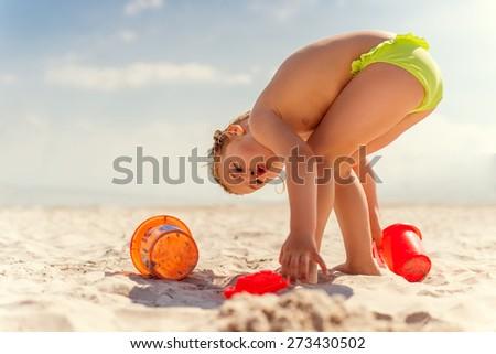 alone player on wide coastline - stock photo