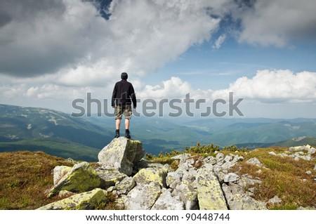 alone tourist on mountain top - stock photo