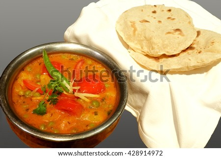 Aloo mutter is made from potatoes and tomato with fresh peas and green chilies. Pure vegetarian dish use as a main course food  eaten with flat bread commonly called Roti. Commonly used in India.