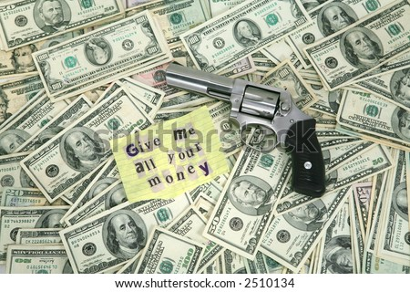 Alot of money with a bank robber note and handgun - stock photo