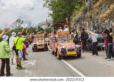 ALPE D'HUEZ, FRANCE, JUL 18:Cochonou vehicles during the passing of the Publicity Caravan on the road to Alpe-D'Huez during the stage 18 of Le Tour de France on July 18 2013.