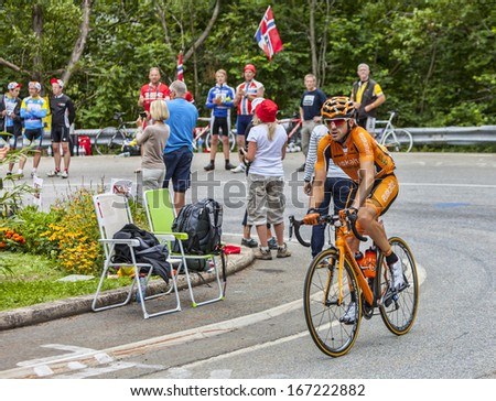ALPE D'HUEZ, FRANCE, JUL 18:The Spanish cyclist Jon Izagirre Insausti from Radioshack Leopard Team climbing the difficult road to Alpe-D'Huez, during the stage 18 of Le Tour de France on July 18 2013.