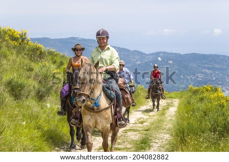 ALPES-MARITIMES, France - 22 JUNE, 2013: Photo of equestrian tourists