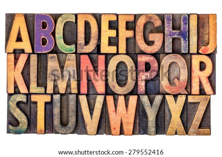 alphabet abstract in vintage letterpress wood type printing blocks, isolated on white - stock photo