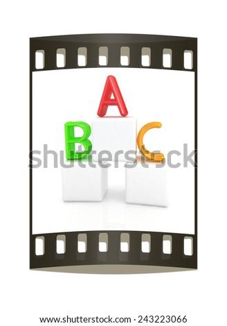 alphabet and blocks on a white background. The film strip - stock photo