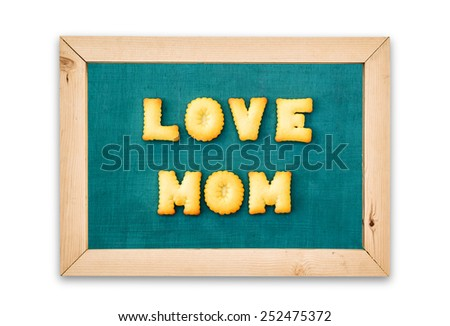 "Alphabet Biscuits ,word "" LOVE MOM "" on chalkboard background. - stock photo"