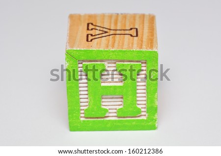 Alphabet block H isolated on a white background - stock photo