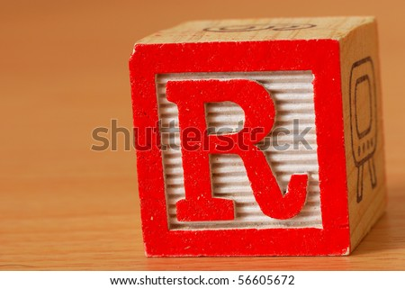 Alphabet block with a red letter R