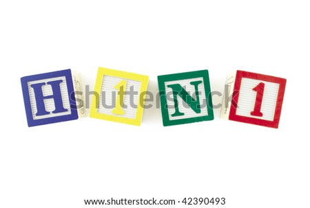 Alphabet blocks forming the word 'H1N1' and viewed from above.