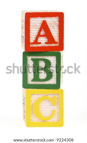 Alphabet blocks lined up to spell abc - isolated on white - stock photo