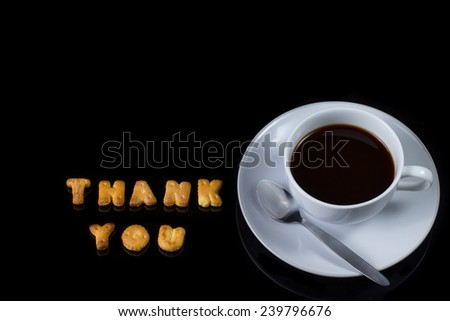 Alphabet cracker with cup of coffee  - stock photo