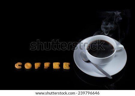 Alphabet cracker with cup of coffee with steam (spelling COFFEE) - stock photo