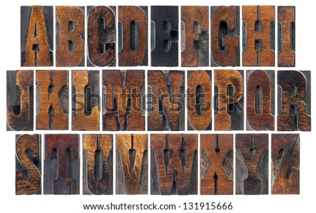 alphabet in vintage letterpress wood type blocks, French Clarendon font popular in western movies and memorabilia, a collage of 26 isolated letters - stock photo