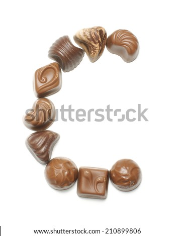 Alphabet letter C arranged from chocolate sweets isolated - stock photo