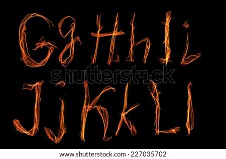 alphabet (letter). fire style - stock photo