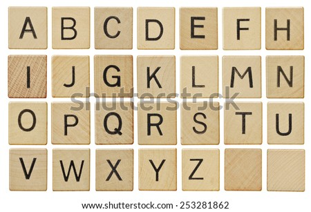 Alphabet letters on wooden scrabble pieces, isolated on white. - stock photo