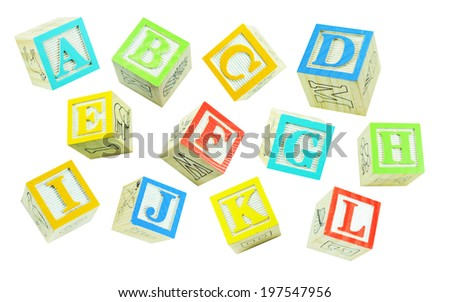 Alphabet made of colorful wooden block letters isolated against white - stock photo