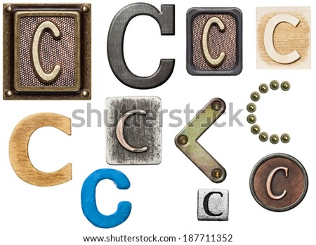Alphabet made of wood, metal, plasticine. Letter C - stock photo