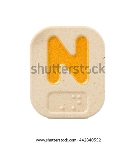 alphabet N on white background  with Braille. - stock photo