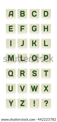 Alphabet on board game square plastic tile pieces, isolated on a white background. - stock photo
