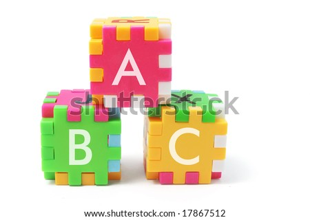 Alphabet Puzzle Cubes on Isolated White Background - stock photo