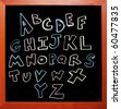 alphabet written in colored chalk - stock photo