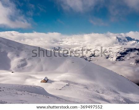Alpine hut deep in the snow - 3 - stock photo