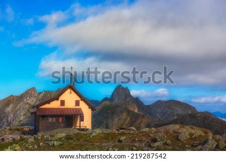 Alpine hut in the solitude - stock photo