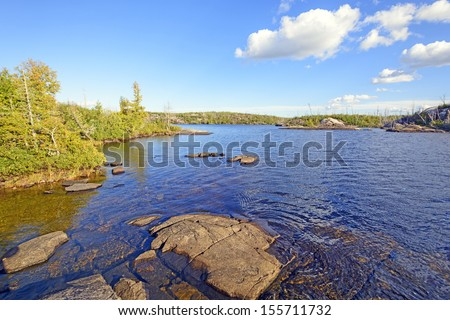 Alpine Lake in the Boundary waters in the evening - stock photo