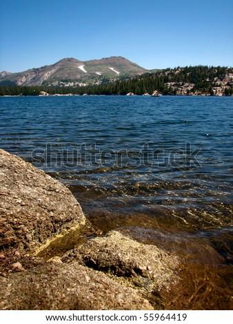Alpine lake in the Sierra Nevada Mountains - stock photo