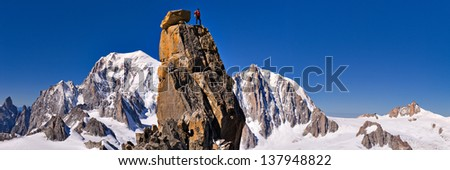 Alpine landscape with lonely man on the top of Mont Blanc, Europe - stock photo