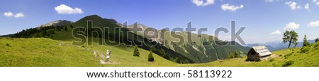 Alpine panorama with mountains and hut - stock photo