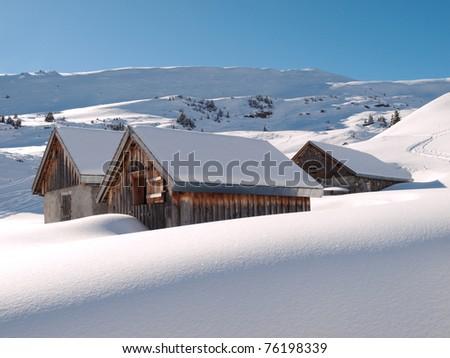 Alpine pasture in a winter landscape - stock photo
