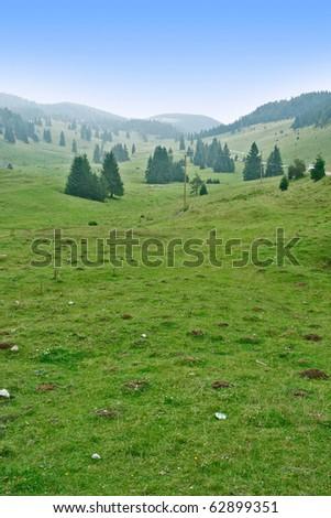 Alpine plateau with hazy fog - stock photo