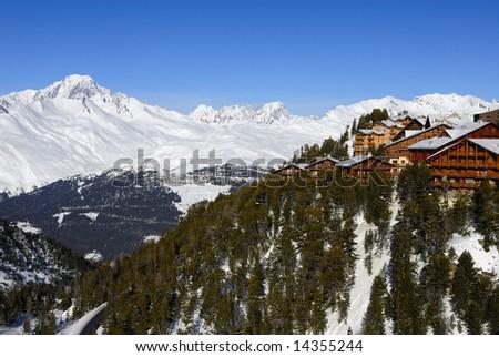 Alpine resort, Mont Blanc mountain range at background. - stock photo
