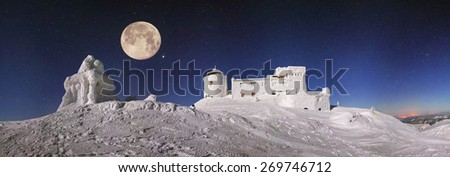 Alpine ridge Montenegro - stands on the slopes of the Ukrainian Carpathians ancient observatory built by the Poles in 1938-39,  snow peaks and bitter cold strong wind waiting climber - extremals - stock photo