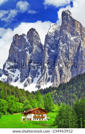 alpine scenery - wooden house in Dolomites, north of Italy - stock photo