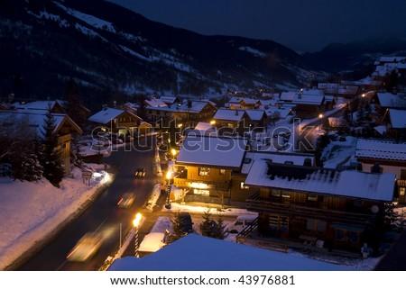 alpine ski resort at night - stock photo