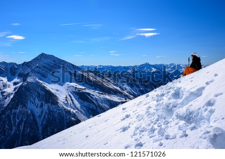 Alpine skier looking at winter panorama of Austrian Alps - stock photo